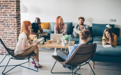 Group of young people spending their time in common living room.